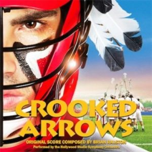 "Brian Ralston: ""This cue titled ""Crooked Arrows Theme Suite"" was intended and recorded to be used as the first cue heard in the End Title crawl for the movie. Later down the road in post, the decision was made to have a little ""behind-the-scenes"" actor, spontaneous rap song play over the credits (with the accompanying video of the actors rapping on set)...then that was followed by an original song written for the film. (Which was all the right decision). So this End Title score cue as heard here did not get used in the film, although it is pulled from a variety of other cues on the score. It is also an expansion of the original theme pitch I made to get on the film in the first place. That main theme never changed over the course of the film they liked it so much. (And yes...there layered in there in the middle is the ESPN Sportscenter theme as those rights were acquired for a scene in the film that required it). It was fun having the opportunity to incorporate that widely known song as a ""counter melody"" to everything else going on."""